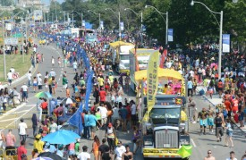 The scene from the bridge with the masses of people enjoying this years Caribana Parade on a very hot and humid day on Lakeshore Rd in Toronto on Aug 04 2012 .VINCE TALOTTA/TORONTO STAR